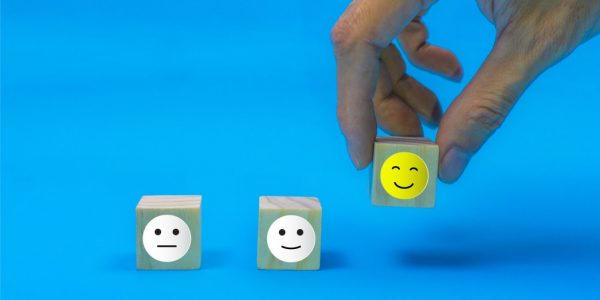 conceptual-the-customer-responded-to-the-survey-the-client-using-hand-choose-happy-face-smile-icon-on_t20_4bJWxx